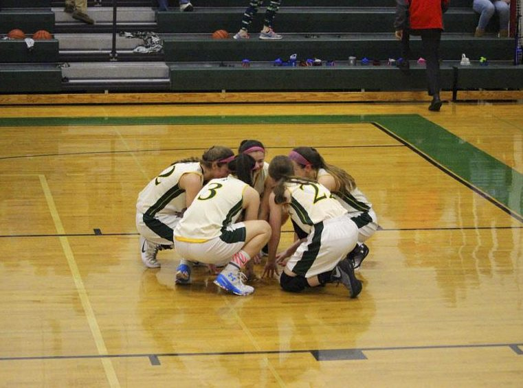 Pascack Valley's starting five (Toriana Tabasco, Shannon Culloo, Kelly Smith, Kelly Petro, Brianna Wong) huddle before the North 1, Group 3 State Sectional Final game against Old Tappan.