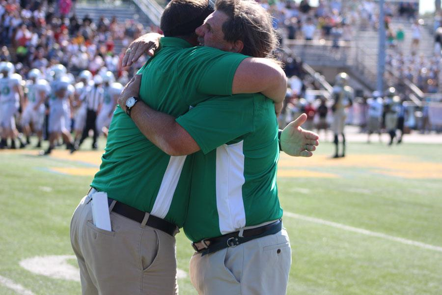 William VanKersen (left) sharing an embrace with longtime head coach Craig Nielsen. Cusumano was named Nielsen's successor on Monday.