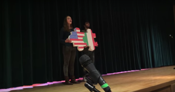 PV senior Laura Santo sings the Italian National Anthem on stage with one of the 24 Italian exchange students.