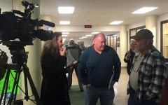 Fox 5 News conducts an interview with James Stankus (Center) during last year's transgender policy hearings.