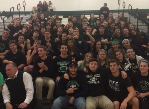 Students get excited for the basketball playoff game on March 2 at Ramapo High School. Bleachers were damaged that night by PVs student fan section and efforts have been made to reimburse Ramapo for repairing the bleachers.