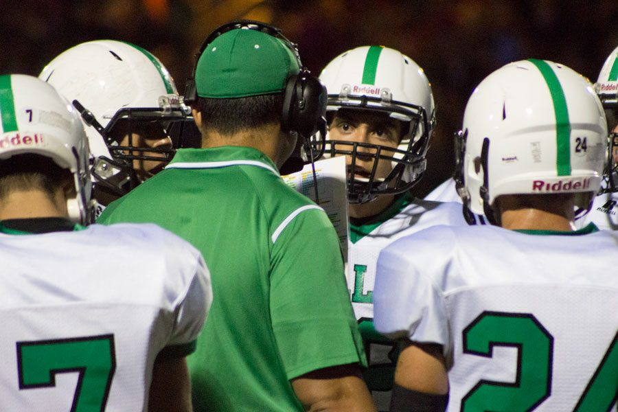PV football coach Len Cusumano chats with his troops during the team's loss to Old Tappan.