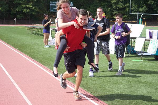 Sophomores, Liam Sandt and Lisa Agranov, run on the track.
