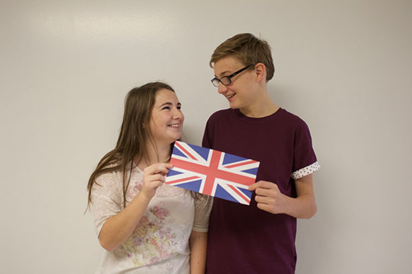 Bethany and Adam Giblin share a smile over the Union Jack. They will be moving back to England this summer.
