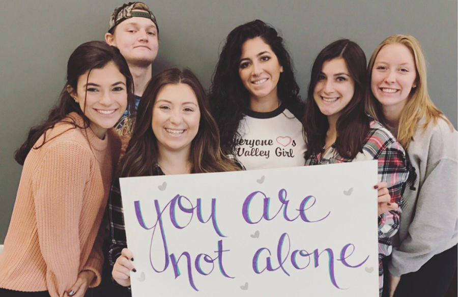 From left, Ashley Evans, Joe Kempka, Ava Prospero, English teacher Ms. Tina Marciano, Kellie Palermo, and Allison Quackenbush show their support for suicide prevention.