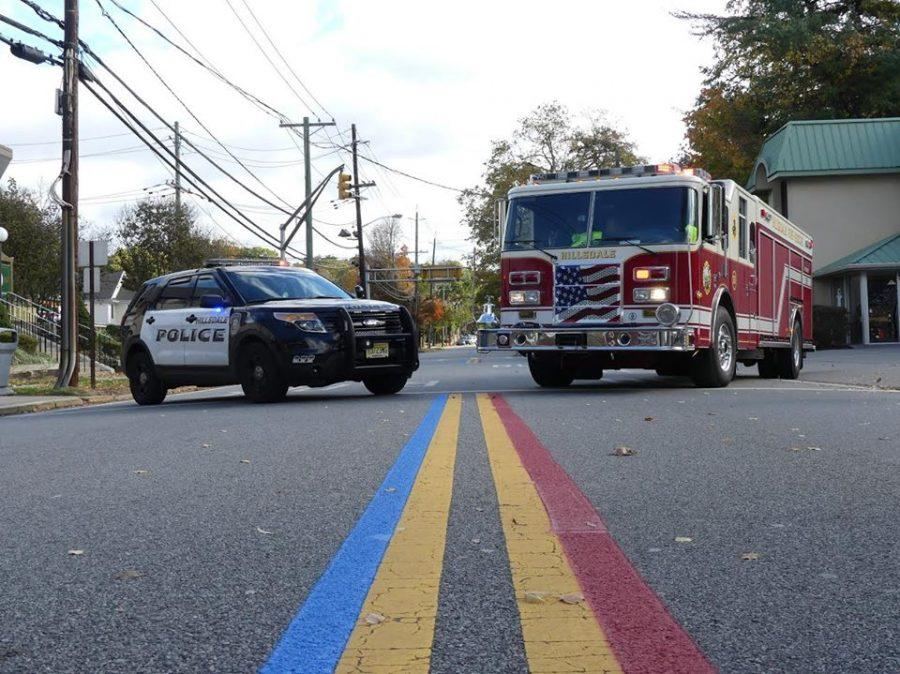 A police car and a Firetruck parked on Hillsdale Ave.