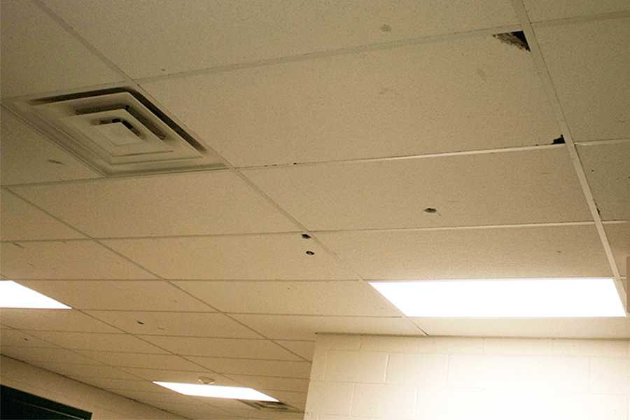 Holes in the ceiling were part of the damage sustained by the PV boys' locker room.