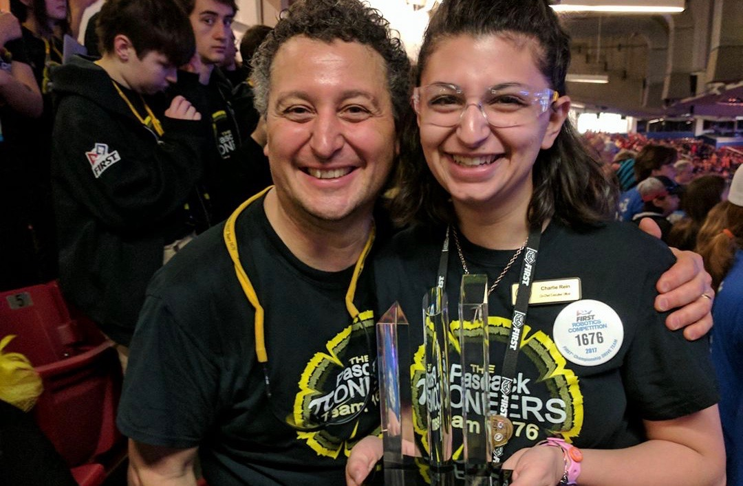 Carlie+Rein+poses+with+supervisor+Mr.+Kevin+Killian+and+an+award.+Rein+is+a+co-CEO+of+the+Pascack+Pi-oneers+robotics+team.