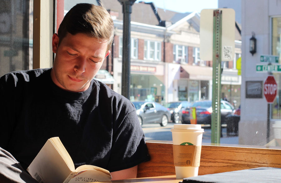 Matt+Kuhl+sits+at+a+local+Starbucks%2C+remembering+his+experiences+made+on+his+trip+to+Mexico.+He+traveled+to+Mexico+with+his+friend%2C+Ben+Misuta%2C+recently.+