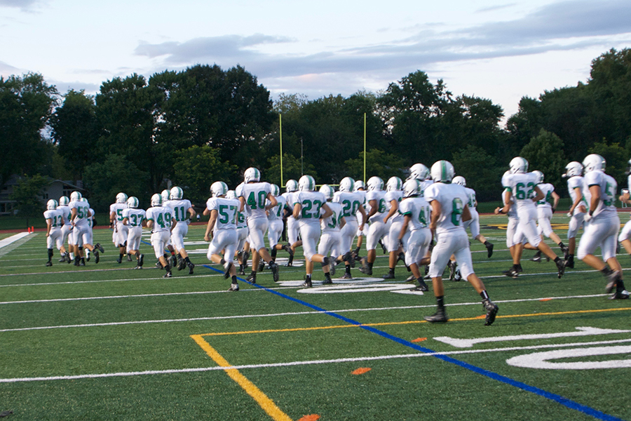 Pascack+Valley+runs+onto+the+field+prior+to+their+first+game+of+the+season+in+River+Dell.+