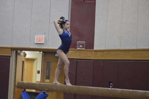 Melissa Ricciardi performs her beam routine.