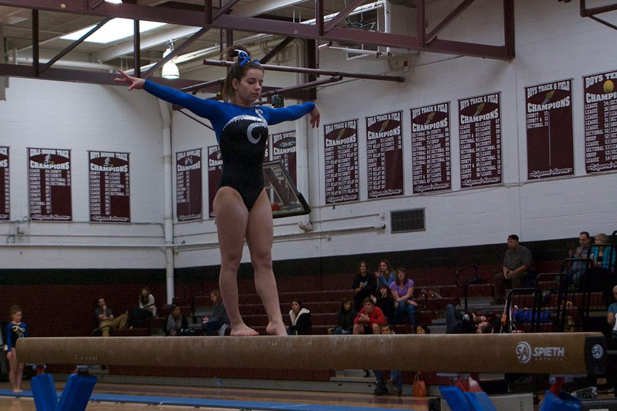 Melissa Ricciardi competes on the beam at the 2017 North 1 Sectionals.