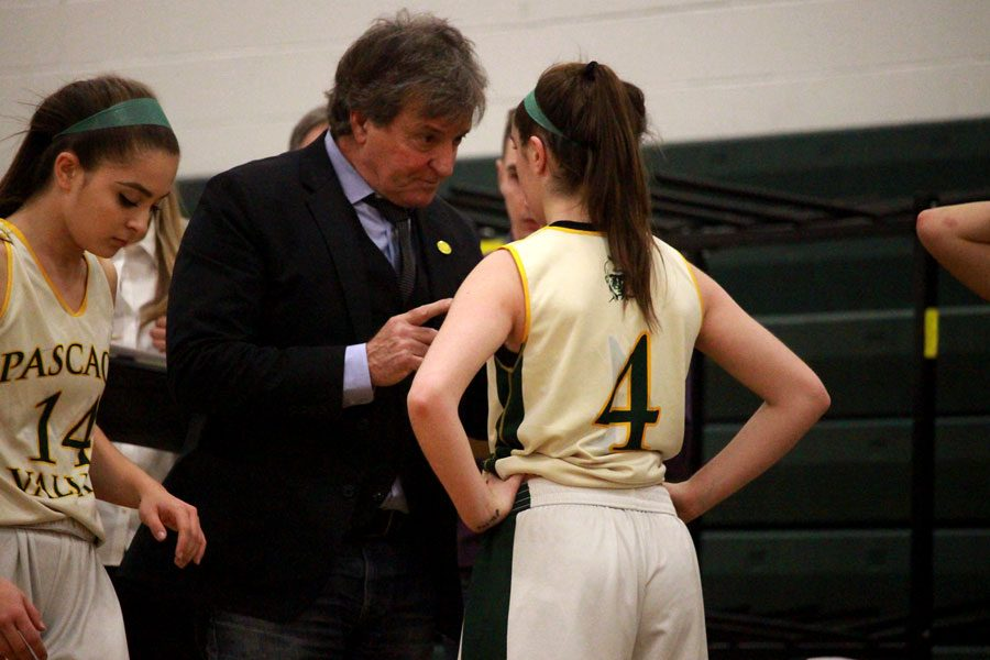 Coach Jeff Jasper gives instructions to Brianna Smith during a break in the action.