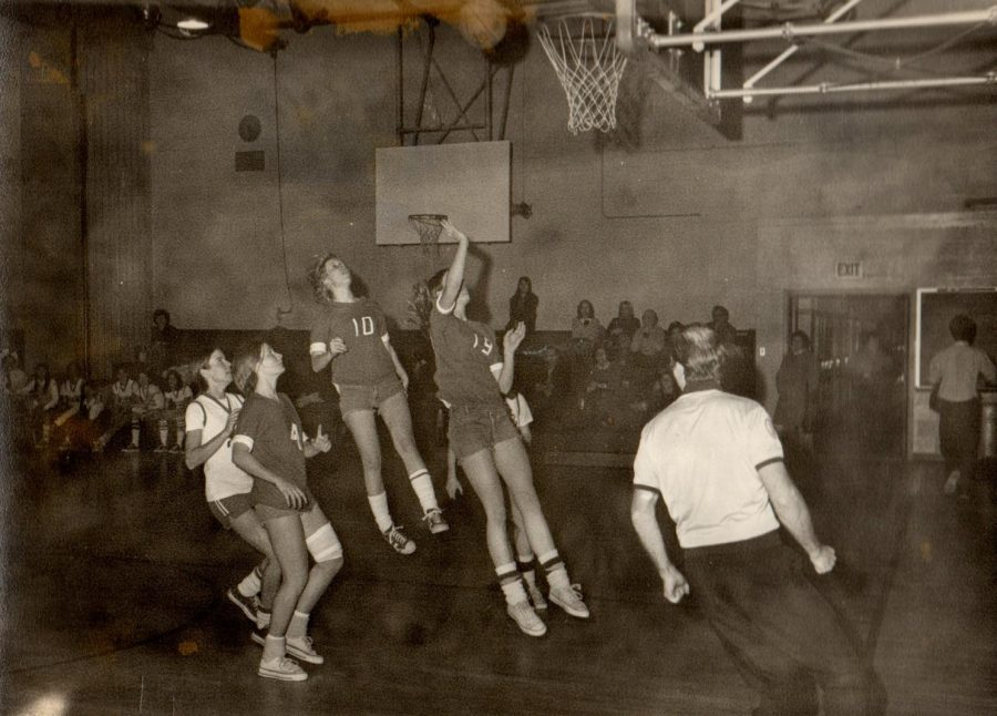 Members of Jasper's first team play a basketball game in 1973. Their uniforms consisted of cutoff jeans and reversible t-shirts with numbers taped on.