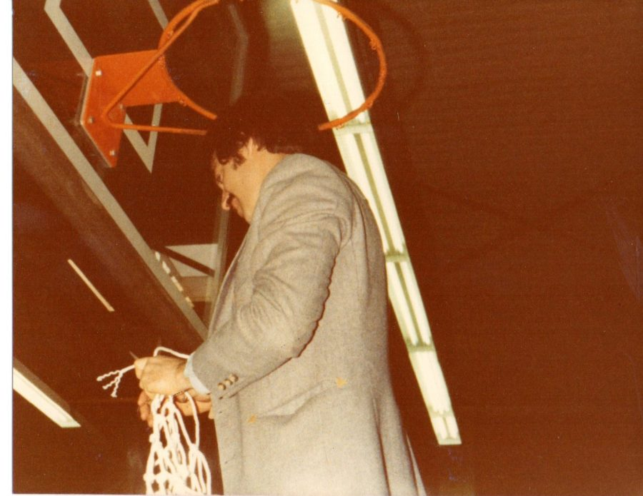 Jeff Jasper cuts down the net after winning his first state title.