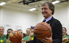 Mr. Jeff Jasper holds up the balls given by the girls basketball team and Dream Team.