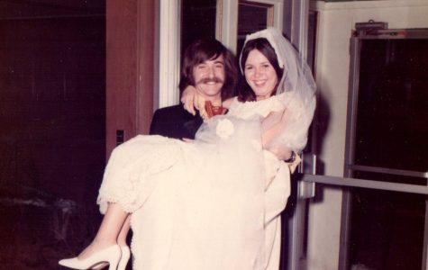 Jeff Jasper carries his bride, Lois Jasper, on their wedding day on March 5, 1972. They have been married for almost 46 years.