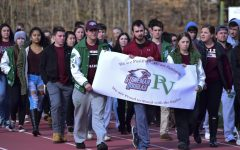 Pascack Valley student organizers lead their fellow students in a lap around the track in memory of the victims of the Parkland High School shooting.