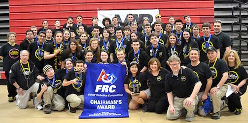 The Pascack Pi-oneers pose with the Chairman's Award. PV juniors Hailey Kraft and Sara Takubo are a part of the robotics team and brought their website to the Pi-oneers.