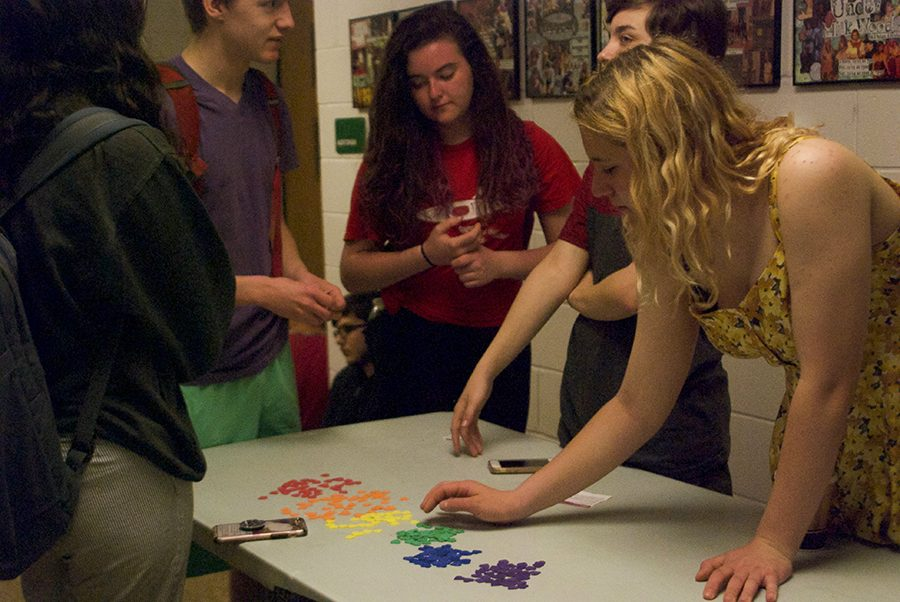 Students+from+the+LGBTQ+club+hand+out+stickers+for+students+participating+in+the+Day+of+Silence+event+to+wear.