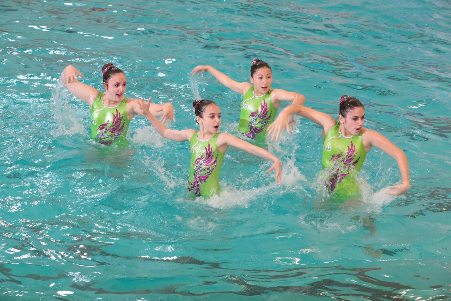 Sophie Altman and members of her synchronized swimming team dance in the pool. Altman joined the team at the Ridgewood YMCA as a freshman and is currently the captain.