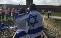 Ally Botwinick and Julia Ganbarg with the Israel flag at Birkenau. They recently went on a trip to participate in March of the Living.