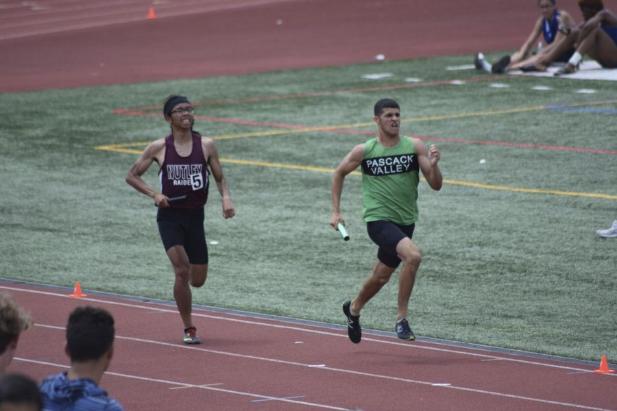 Andrew Martinez runs around the track during a meet. The junior will play a key role for the spring track team.