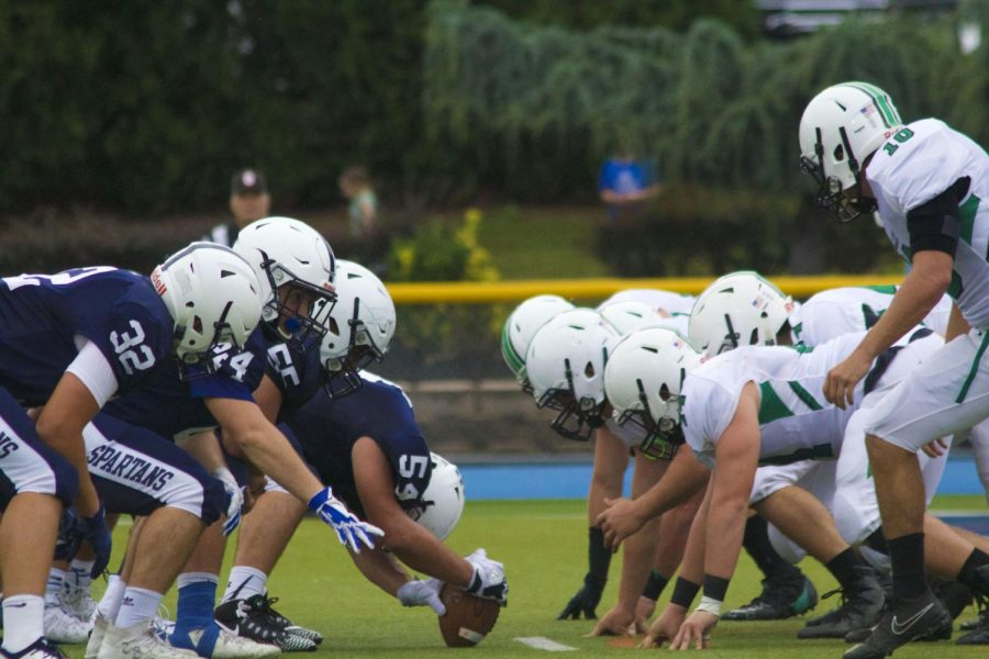 The Paramus center prepares to snap the ball as the PV defense readies to pounce. The Paramus offense scored 48 points on Friday.