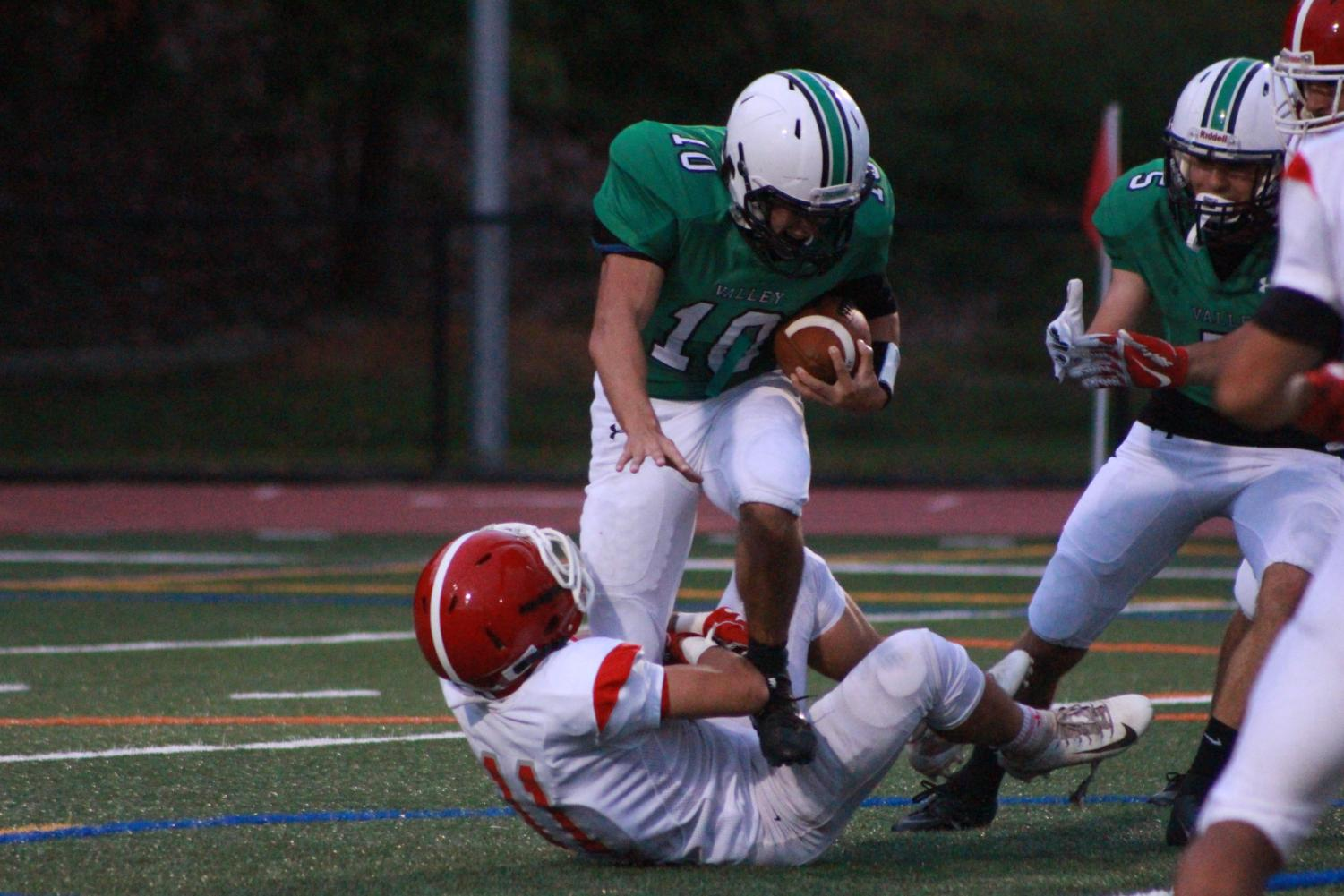 Senior Stephen Soravilla (10) returns an interception against Ridgefield Park. Soravilla recorded an interception and blocked a punt.