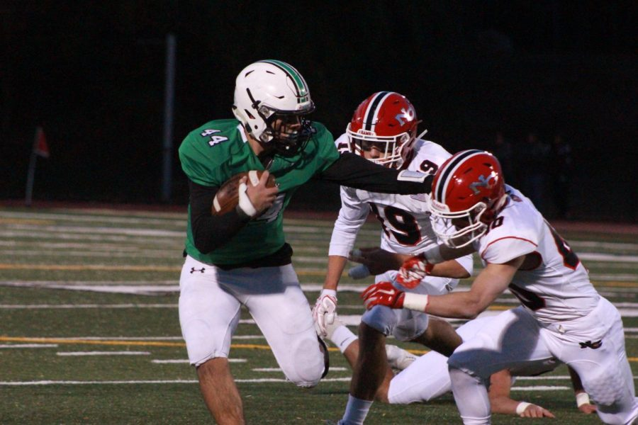 Jake Williams carries the ball for Pascack Valley. Williams scored PV's lone touchdown in a 42-7 loss against the New Canaan Rams.