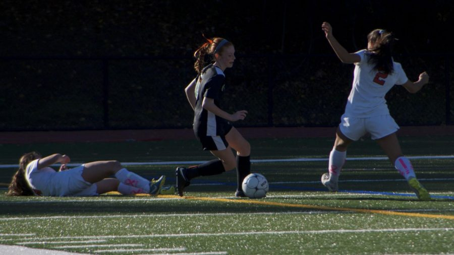 Paige Skene makes her way around defenders to approach the goal.