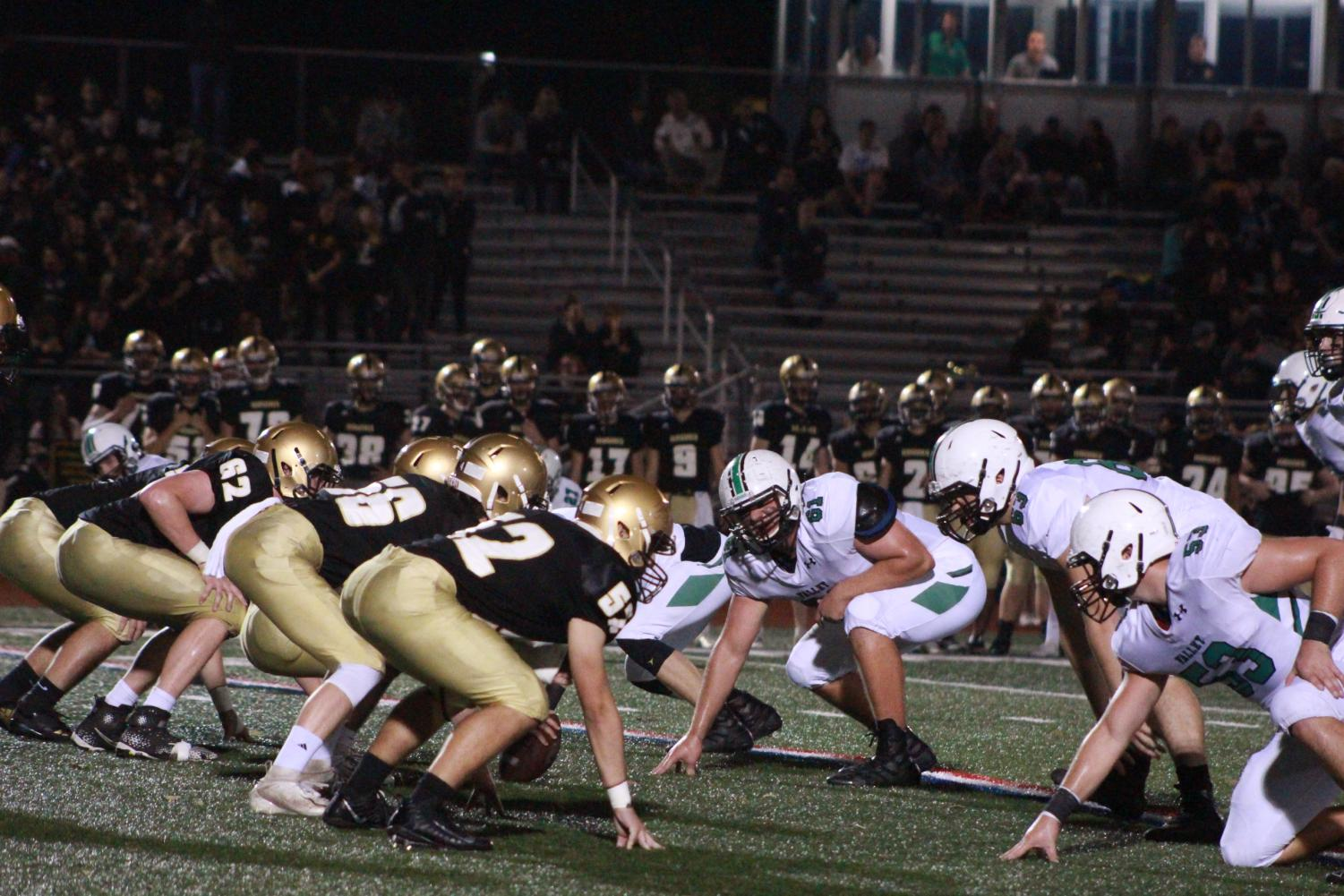 Lineman from both Pascack Valley and River Dell line up and get ready for the snap. The Golden Hawks won by a final of 42-6, ending the Indians' season.