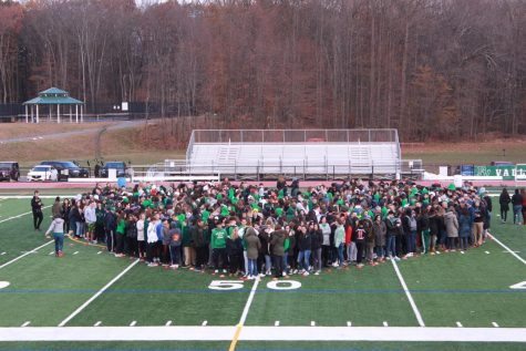 Students stand in the shape of a heart during the Movement of Unity.