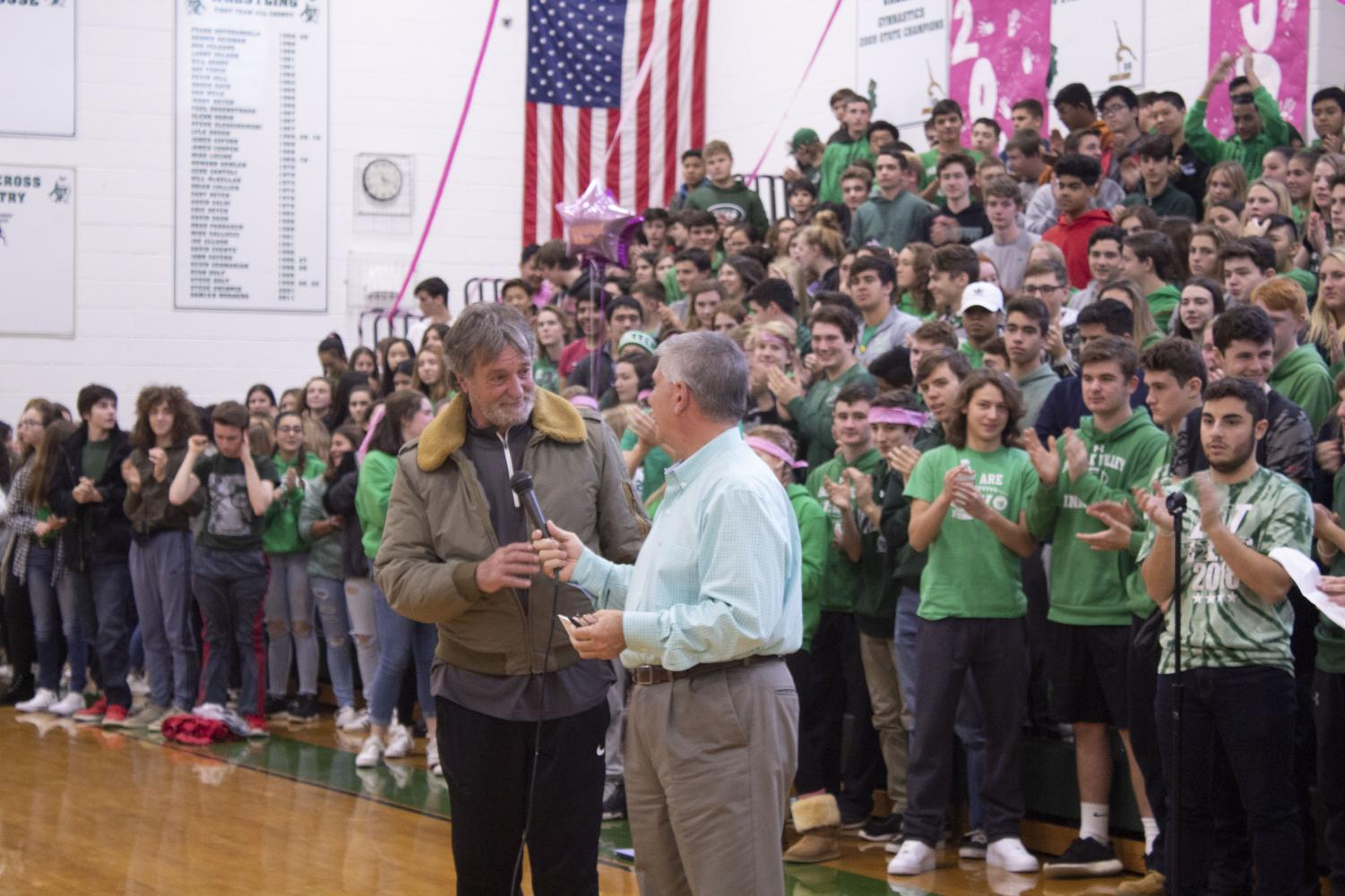 Pascack Valley principal Tom DeMaio with Jeff Jasper. The Pascack Valley new gym basketball court was renamed Jasper Court in honor of Jasper at the Nov. 21 Valley Cup assembly.
