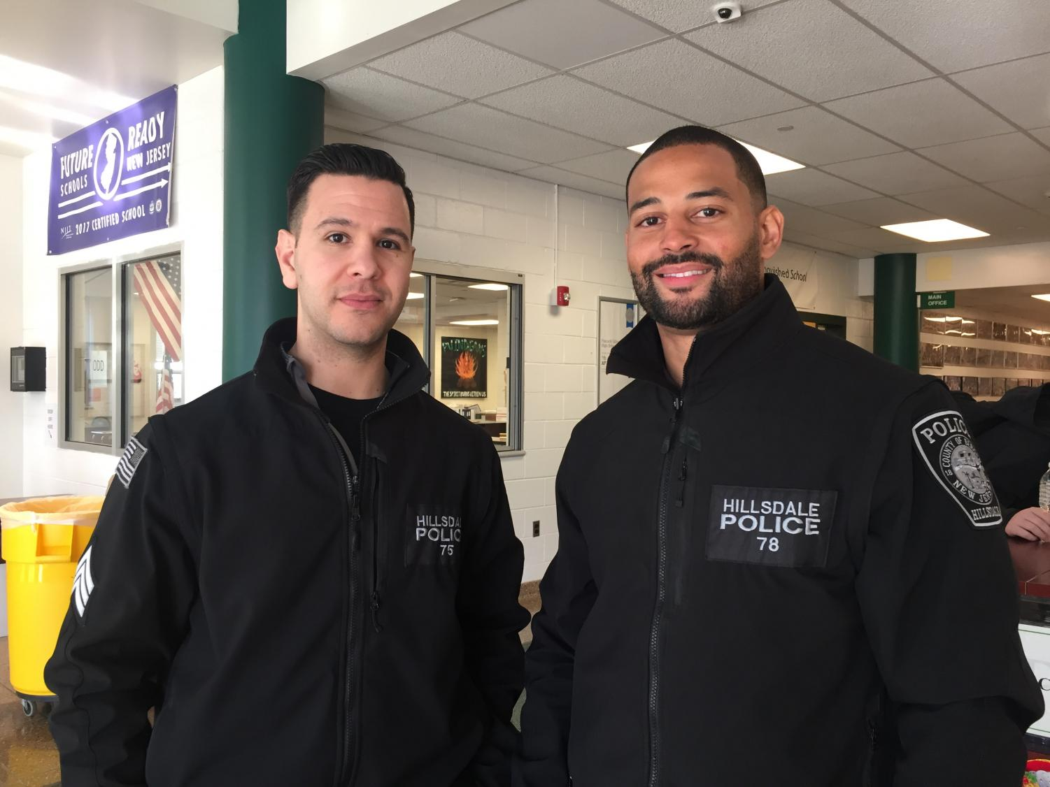 A parting officer, Mike Campereale, stands with Pascack Valley's new student resource officer, German Decena. Decena began working at PV on Dec. 10.