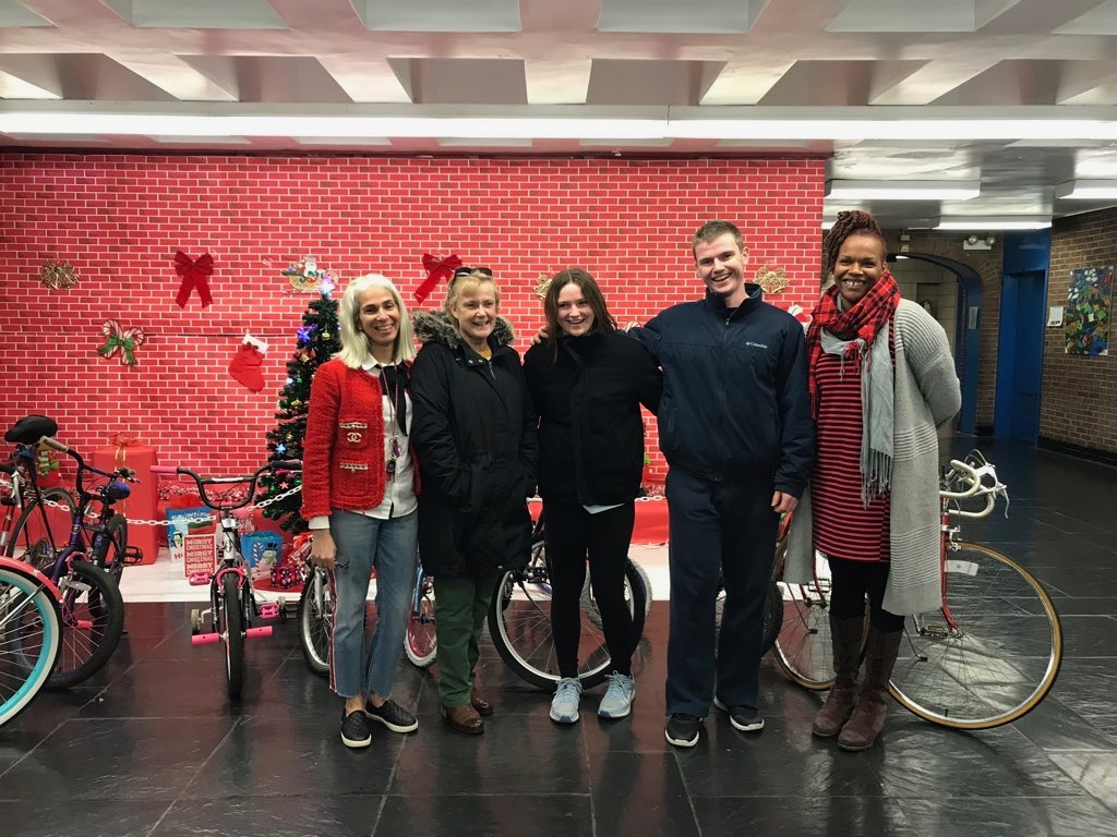 Bailey McNamara, Kirk McNamara, and Peggy Lundquist deliver the donated bikes they collected to Public School Precinct 46 in Harlem, Manhattan on Dec. 12. They recieved a total of 27 bikes to donate to students who are less fortunate.