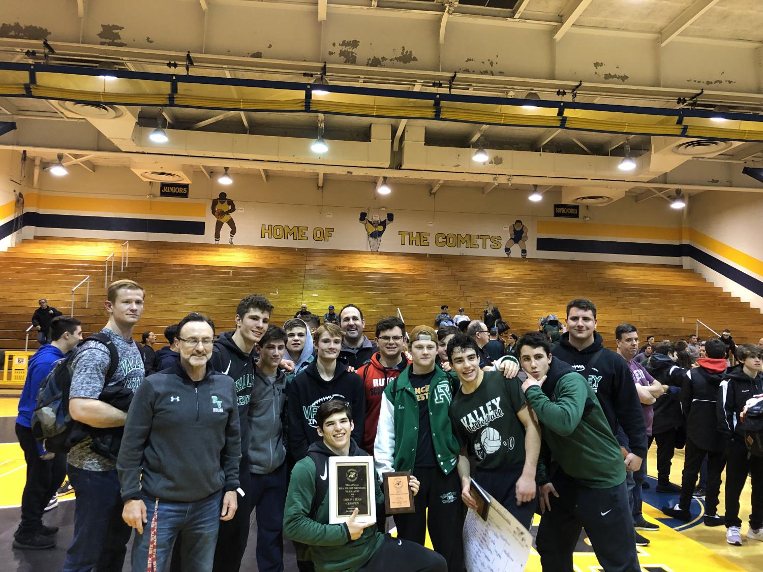 Pascack Valley wrestlers and coaches pose after the BCCA Holiday Wrestling Tournament on Friday. Seniors Tommy Chiellini and Matt Beyer won county titles at their respective weight classes.