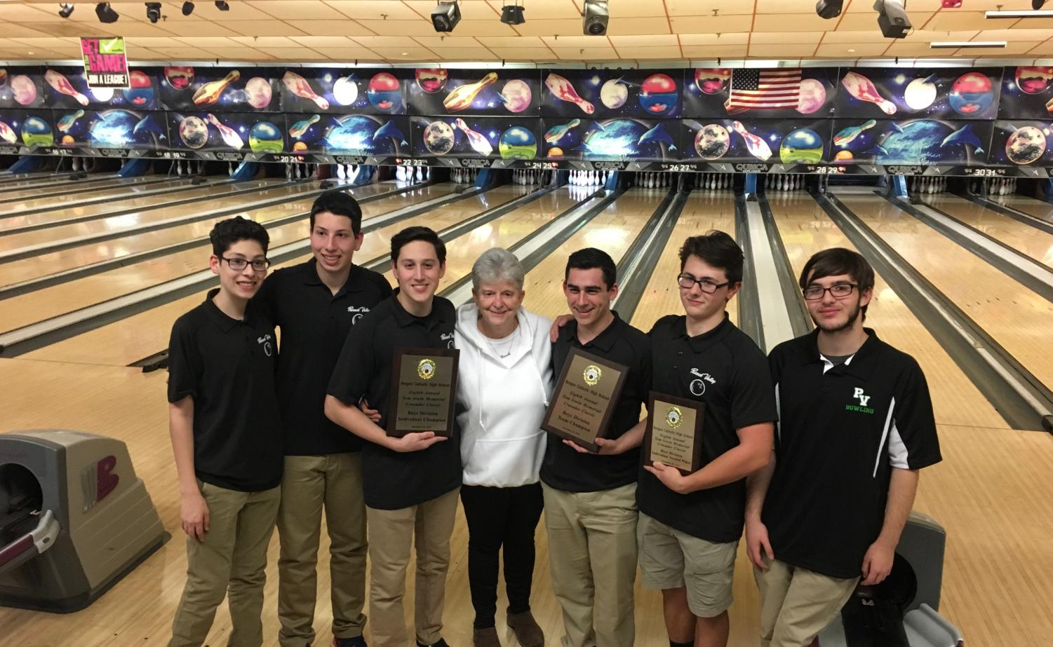 (From left) Evan Murad, Jake Murad, Trevor Lauber, Coach Judy Lucia, Scott Morris, Brian Biml, and James Holland pose after the Indians win in the Tom Irwin Classic. Valley will look to continue its early success and eventually emerge victorious in the county and state sectional tournaments.