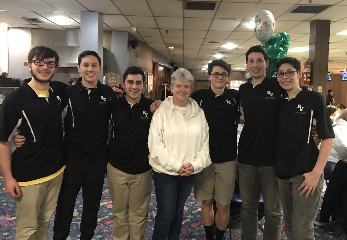 Bowlers James Holland, Trevor Lauber, Scott Morris, Brian Biml, Jake Murad, and Evan Murad pose with coach Judy Lucia. The Indians finished fifth in the Bergen County Tournament.