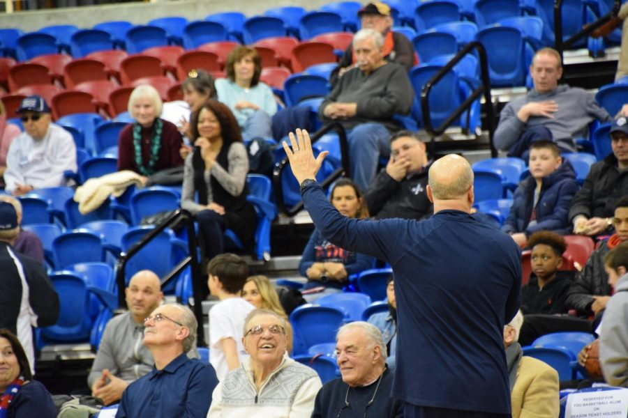 FDU coach Greg Herenda waves to the fans that came to support his team on Sunday. Herenda is a resident of Hillsdale, New Jersey.