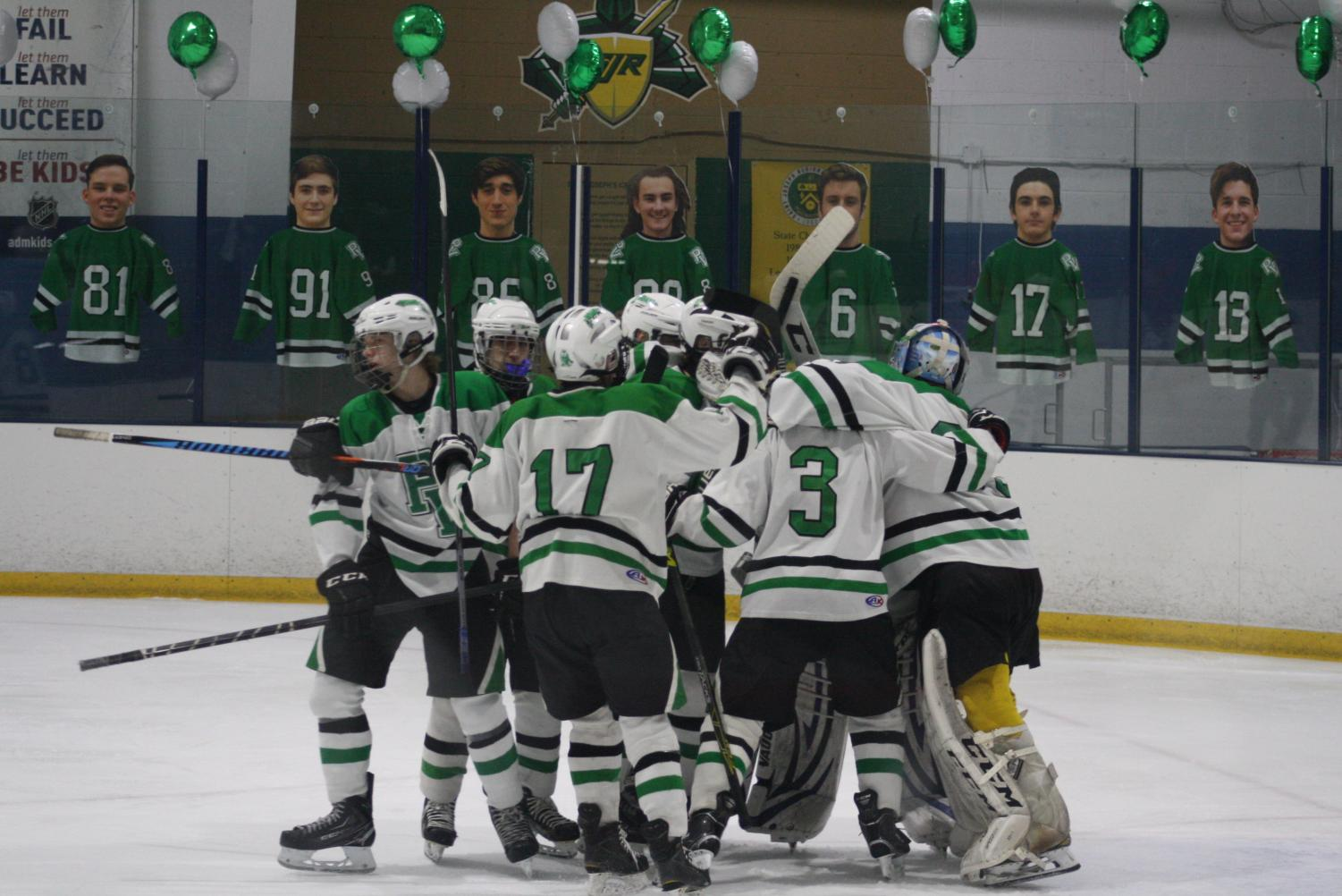 PV/PH/PR hockey players celebrate during a game from this past season. Park Ridge students joined Pascack Hills and Pascack Valley on the team for the first time this past season.