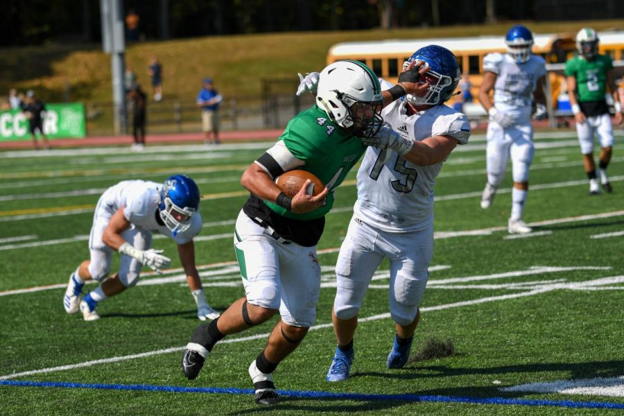 Senior running back Jake Williams stiff-arms a defender. Williams would rush for 145 yards and four touchdowns in the win.