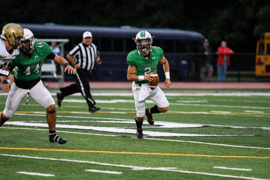 Senior Stephen Begen scrambles outside the pocket. He threw for 110 yards and scored two total touchdowns before exiting early.