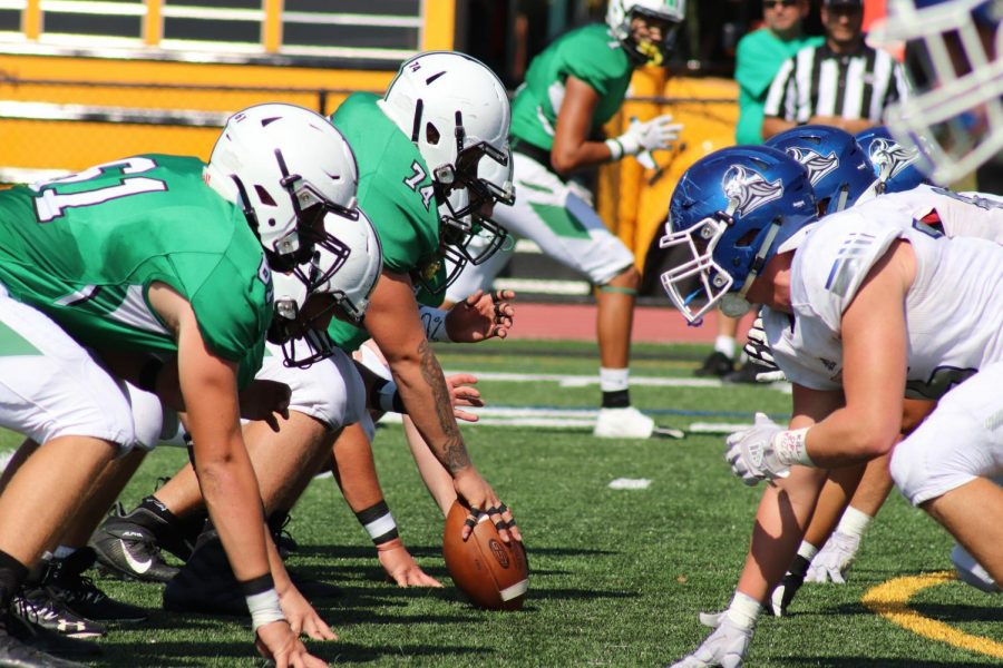Pascack+Valley+and+Demarest+get+set+at+the+line+of+scrimmage.+The+Indians+went+on+to+defeat+the+Norsemen+48-18+in+Valley%27s+Homecoming+game+on+Sept.+28%2C+and+the+two+teams+are+now+set+for+a+rematch+in+the+playoffs.