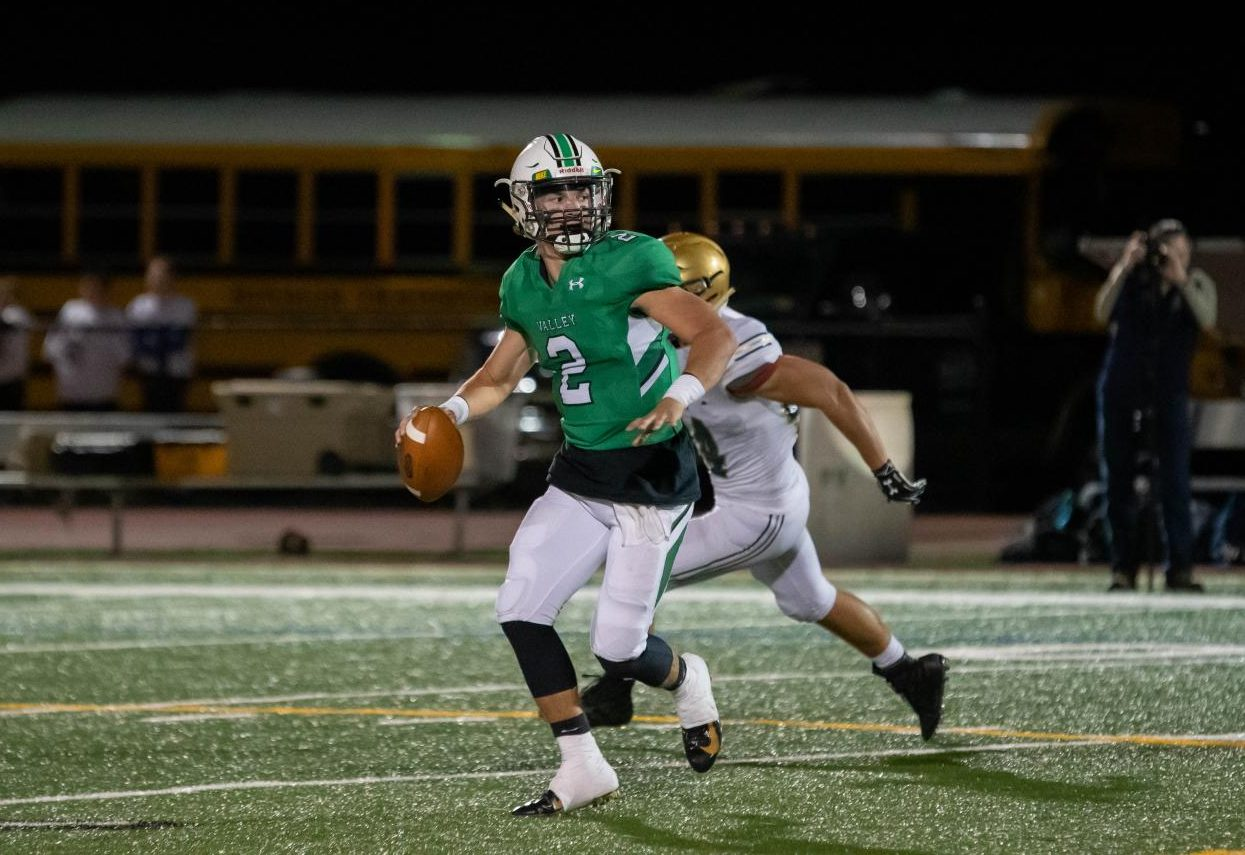 Senior quarterback Stephen Begen rolls out of the pocket while looking to pass. He finished with 151 passing yards, two total touchdowns and two interceptions in Valley's 21-12 loss to Old Tappan on Friday night.