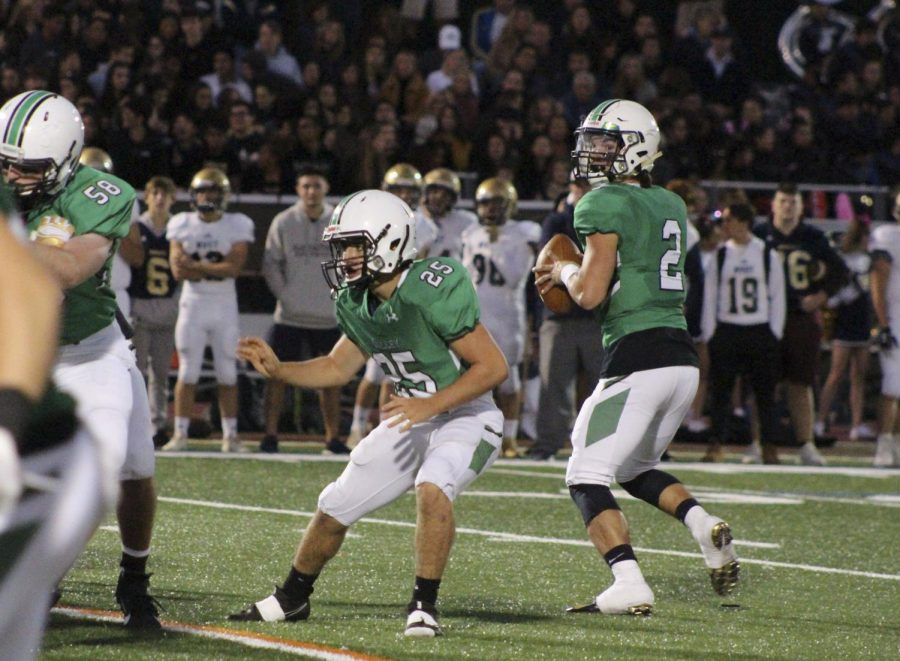 Senior quarterback Stephen Begen drops back to pass. He threw for 151 yards, a touchdown, and two interceptions in last week's loss to Old Tappan.