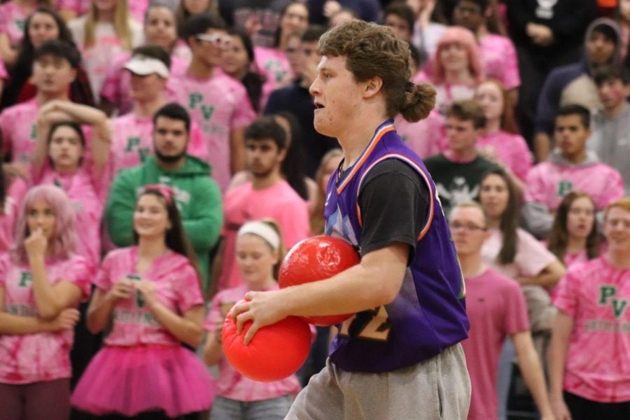 Senior James Allmers prepares to throw a ball during the dodgeball game.