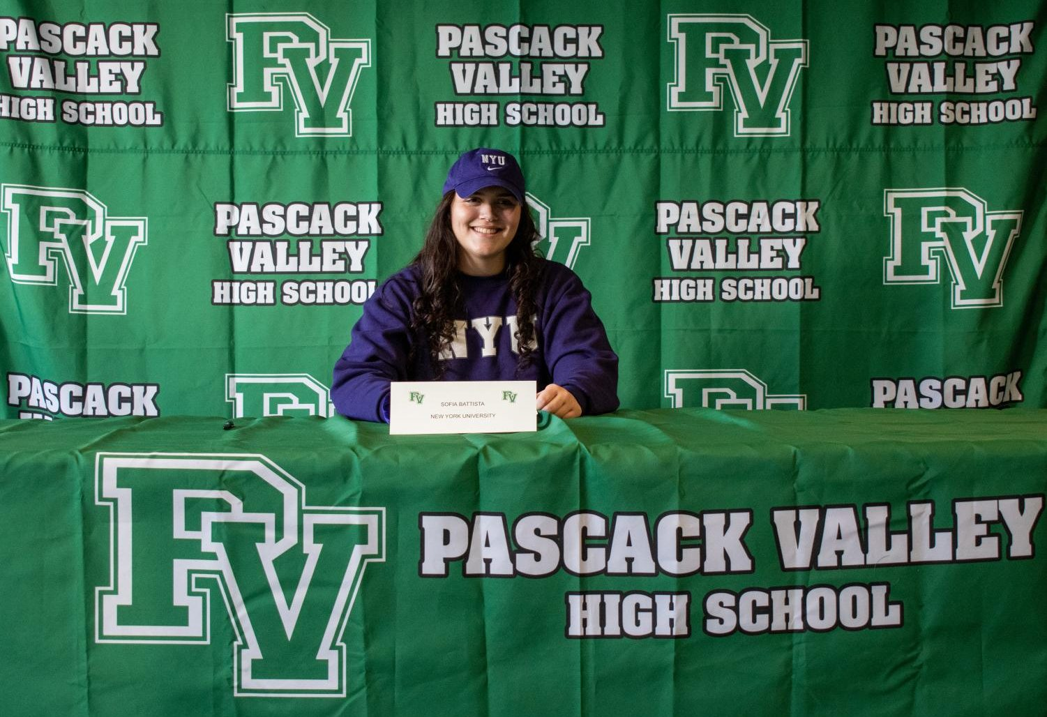 PV senior Sofia Battista at the podium of Pascack Valley's winter signing day ceremony, where she officially committed to NYU for basketball.