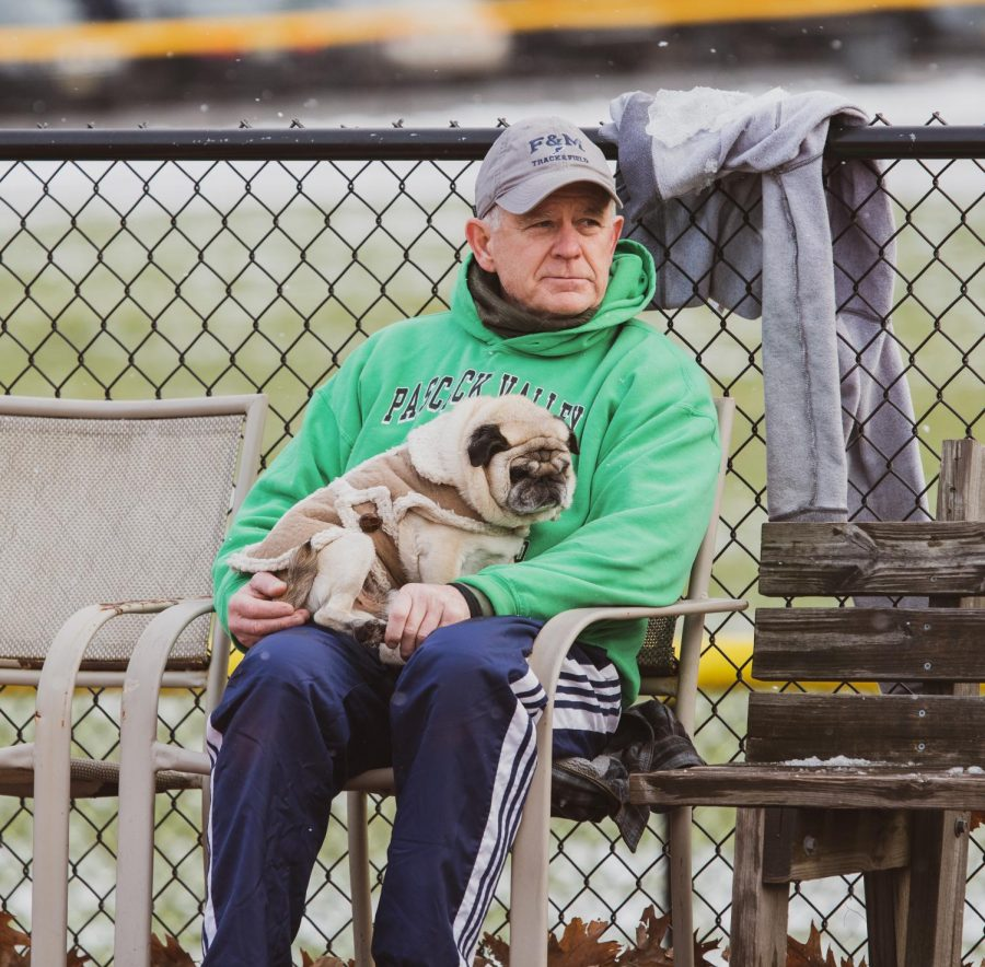 Track+Coach+John+Murtaugh+and+his+dog%2C+Doug%2C+watch+the+team+warm+up+during+practice.