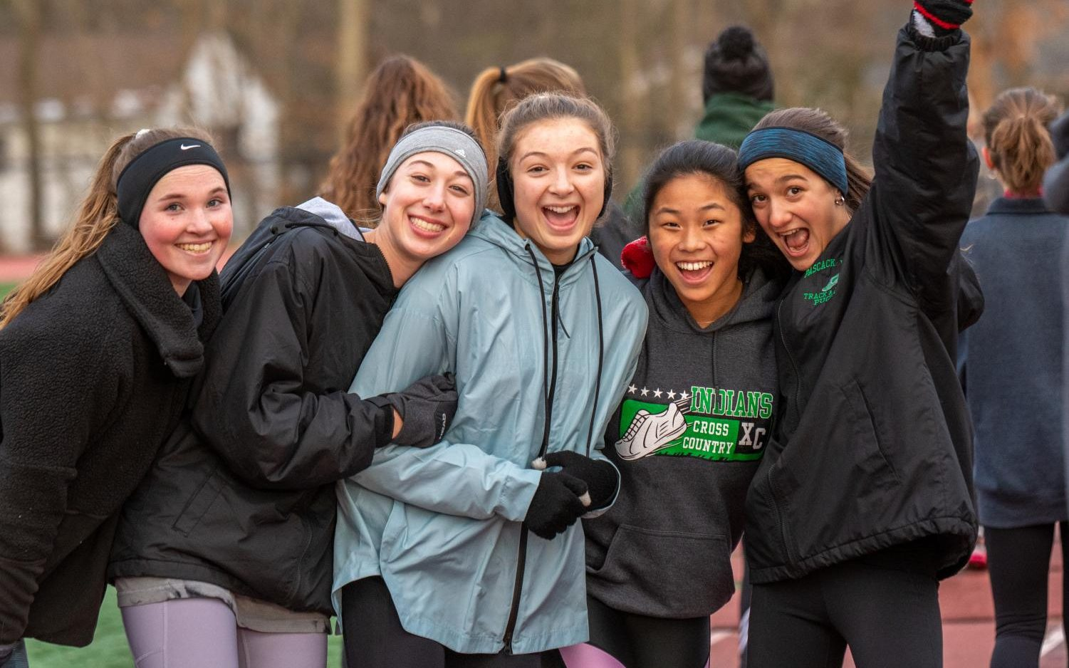 Sophomores Shannon Connelly, Julianna Mullaney, Emma Epiphaniou, Ai Lin Doody and Mia Puccio pose for a picture at a track practice during the teams first week of training.